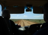 view from the bus of the dirt road leading to Tibooburra